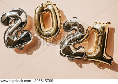 Gold And Silver Numbers 2021 On A Pink Background. New Year And Christmas Celebration Concept In Min
