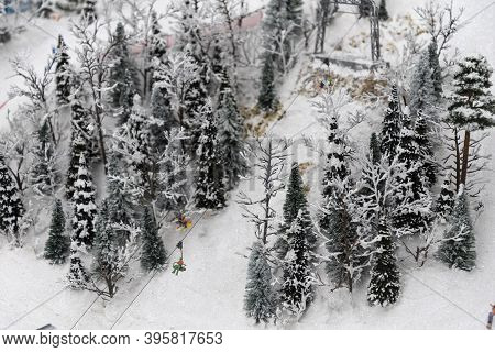 Miniature Of Realistic Ski Slope. Winter And Skiing.
