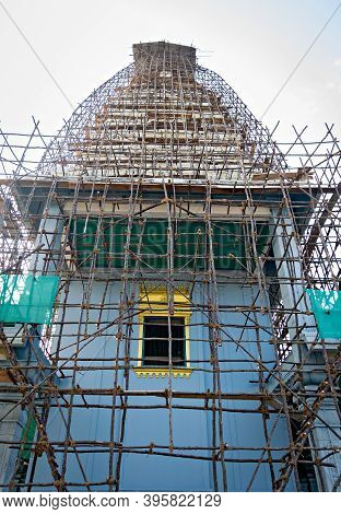 South Indian Temple Covered With Bamboo Cage Erected For Painting Work.