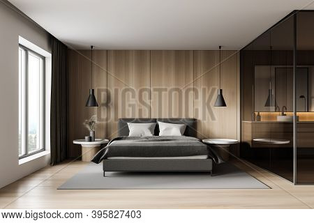 Interior Of Modern Master Bedroom With White And Wooden Walls, Wooden Floor And Comfortable King Siz