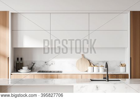 Interior Of Modern Kitchen With White Walls And Cupboards With Built In Sink And Cooker. 3d Renderin