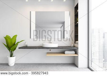 White Bathroom, Sink And Big Mirror With Shelves. Open Space Bathroom With Grey Floor And Plant. Big