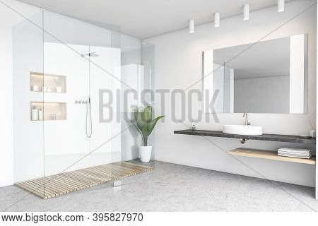 Shower Cabin In White Bathroom With Sink And Towels, And Mirror. Light Open Space Bathroom With Plan
