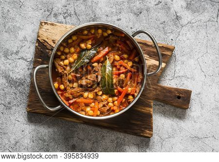 Slow Cooker Beef Stew With Chickpeas In A Pot On A Grey Background, Top View