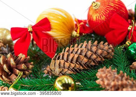 Background With Fir Branches, Cones And Christmas Paraphernalia