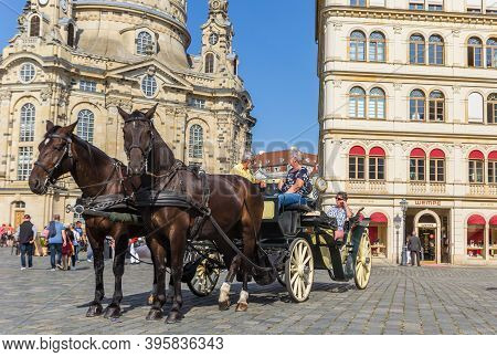 Dresden, Germany - September 11, 2020: Horses And Carriage In Front Of The Frauenkirche Church In Dr