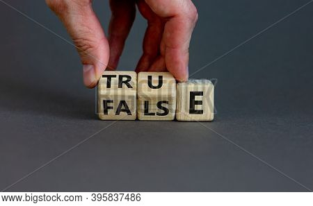 False Or True. Male Hand Flips Wooden Cubes And Changes The Word 'false' To 'true' Or Vice Versa. Be
