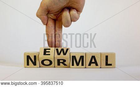 New Normal And Covid-19 Pandemic Concept. Words 'new Normal' On Wooden Cubes On A Beautiful Wooden T