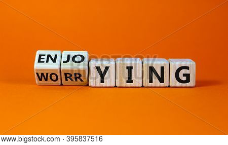 Worring Or Enjoying Concept. Turned Wooden Cubes And Changed Word 'worring' To 'enjoying' On A Beaut