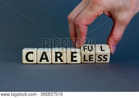 Careless Or Careful Concept. Male Hand Flips Wooden Cubes And Changes The Word 'careless' To 'carefu
