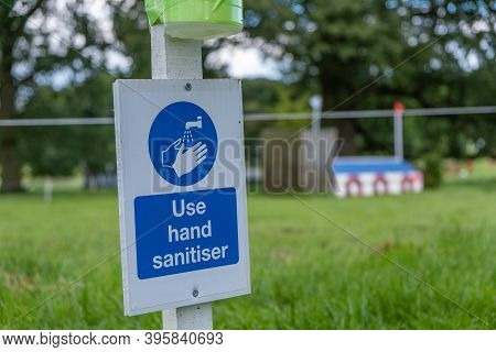 A Sign Asking Visitors To Use Hand Sanitiser At An Outdoor Equestrian Event As The Coronavirus Lockd