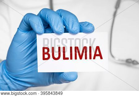 Doctor Holding A Card With Text Bulimia, Medical Concept