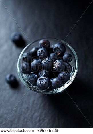 Bilberries On Dark Stone Background. Close Up.