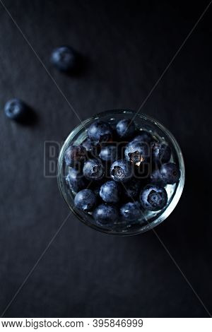 Bilberries On Dark Background. Top View. Close Up.