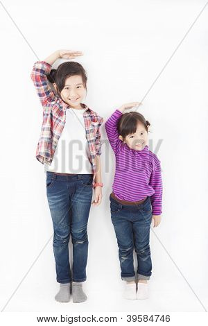 Two Beautiful Asian Little Girls Standing Together