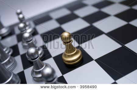 Gold Chess Pawn In Front Of White Troop