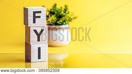 Fyi - Acronym From Wooden Blocks With Letters, Fyi - For Your Information. Yellow Background.