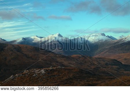 Magnificent Landscape Of Mountain Peaks Covered Snow At Sunset. View From The Devils Staircase To Bi