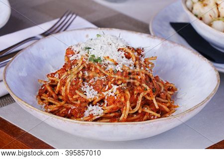 Spaghetti Bolognese With Parmesan Cheese And Herbs.