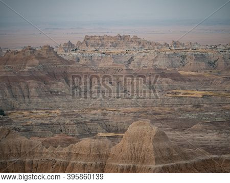 View Of The Pinnacles Section Of Badlands National Park In South Dakota. The Rugged Mountains Are Ba