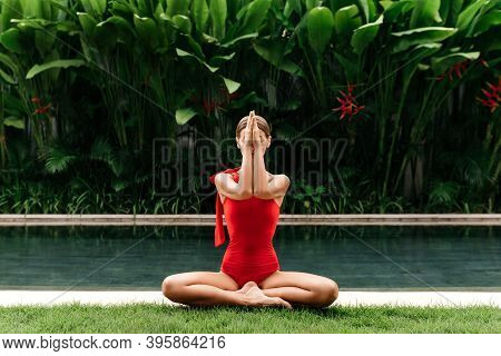Young Woman Practicing Yoga Outdoors. Relaxation Harmony Lifestyle Concept