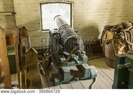 Cannon Pointed Out A Window For  Protection Against Unfriendly Attack
