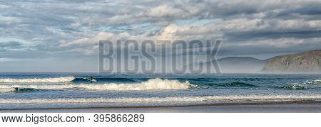 Valdovino / Galicia / Spain - 18 November 2020: Surfing At A Frouxeira Beach In Galicia In Northern