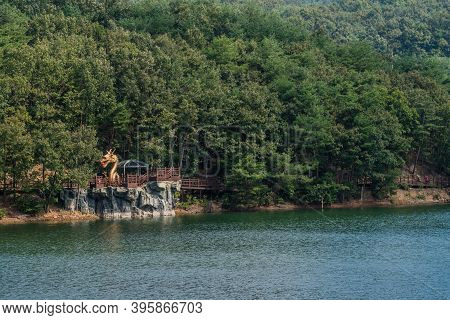 Cheongyang-gun, South Korea; October 2, 2020: For Editorial Use Only. Statute Of Gold Dragon As Part