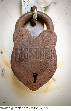 Rusted Old Lock On A Door Latch For Safety. Vintage Lock Over A Outdoor Room.