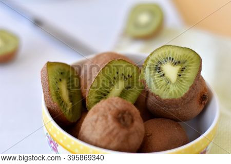 Healthy Nutrition/ Delicious Ripe Kiwi Fruits In A Ceramic Bowl/ Healthy Eating Or Healthy Lifestyle