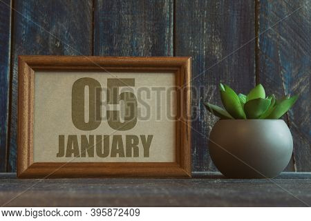 January 5th. Day 5 Of Month, Date In Frame Next To Succulent On Wooden Background Winter Month, Day