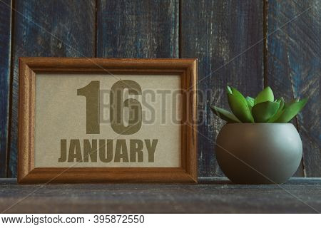 January 16th. Day 16 Of Month, Date In Frame Next To Succulent On Wooden Background Winter Month, Da