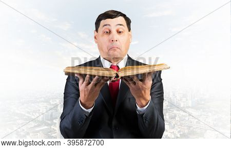 Surprised Businessman Looking In Open Book. Startled Adult Man In Business Suit And Tie Standing On