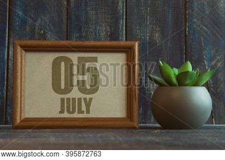 July 5th. Day 5 Of Month, Date In Frame Next To Succulent On Wooden Background Summer Month, Day Of