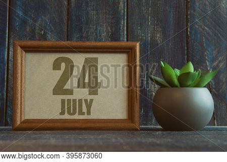 July 24th. Day 24 Of Month, Date In Frame Next To Succulent On Wooden Background Summer Month, Day O