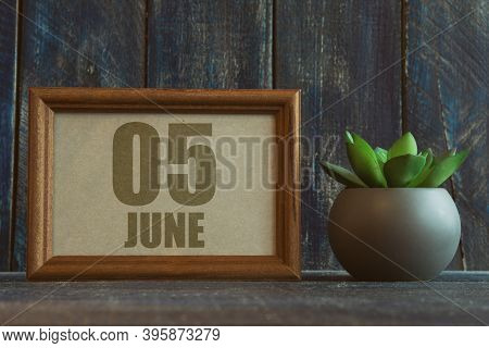 June 5th. Day 5 Of Month, Date In Frame Next To Succulent On Wooden Background Summer Month, Day Of