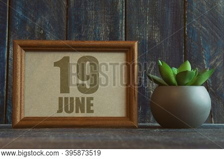 June 19th. Day 19 Of Month, Date In Frame Next To Succulent On Wooden Background Summer Month, Day O