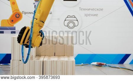 Robotic Arm On Industrial Unloading. Media. Modern Robotic Technology In Industry. Mechanical Hands