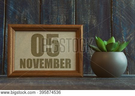 November 5th. Day 5 Of Month, Date In Frame Next To Succulent On Wooden Background Autumn Month, Day