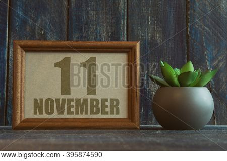 November 11th. Day 11 Of Month, Date In Frame Next To Succulent On Wooden Background Autumn Month, D