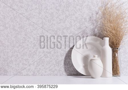 Tranquil Soft Light Home Decor With Ceramic Crockery, Bottle, Vase And Dried Herb Bouquet In Morning