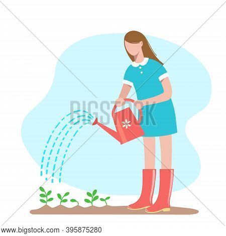 Gardening. Young Woman In Her Garden Waters Plants From A Watering Can.