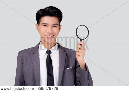 Young Asian Business Man In Suit Look Magnifying Glass For Search Isolated On White Background, Busi