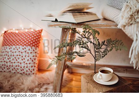 Cup Of Coffee In Cozy Reading Space On The Floor.