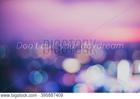 Don't quit your daydream quote on a bokeh background