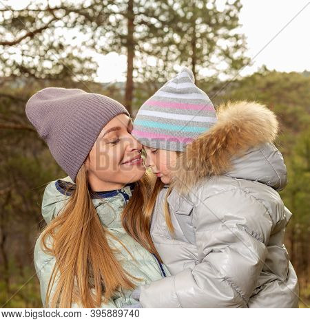 Mother Love Your Daughter. Mother And Little Girl In Autumn Forest.