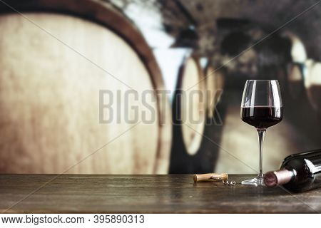 Wine Cellar With Bottle Of Wine, Glass And Corkscrew. With Space For Text. Wine Tasting  And Drinkin
