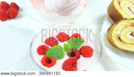 Sweet Desserts Yoghurt With Fresh Raspberries And Mint, Marshmallows And Tender Biscuit With Cream,