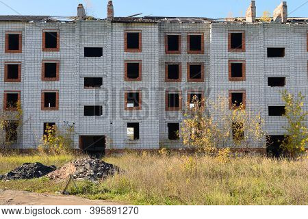 Old Apartment Building Collapsing Unfinished On A Summer Day