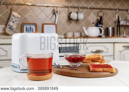 White Toaster, Cup Of Black Tea, Slices Of Toasted Bread, Crispy Toast With Raspberry Jam And Bowl W